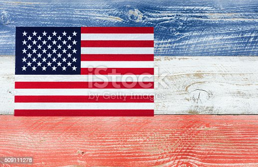 istock USA flag with national colors painted on fading wooden boards 509111278