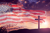 USA flag with sunset sky and Good Friday, Easter cross.