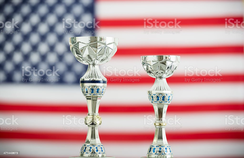 US flag with the winner trophy cup royalty-free stock photo