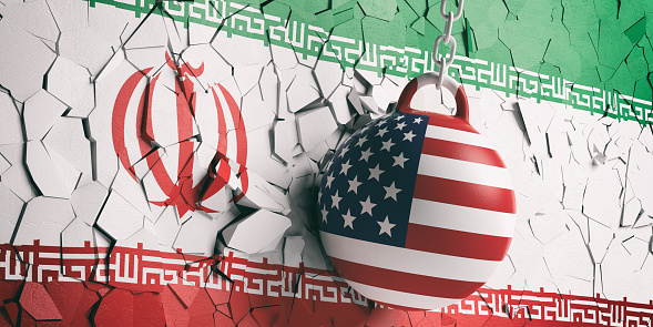 istock USA flag wrecking ball breaking a Iran flag wall. 3d illustration 1048647866