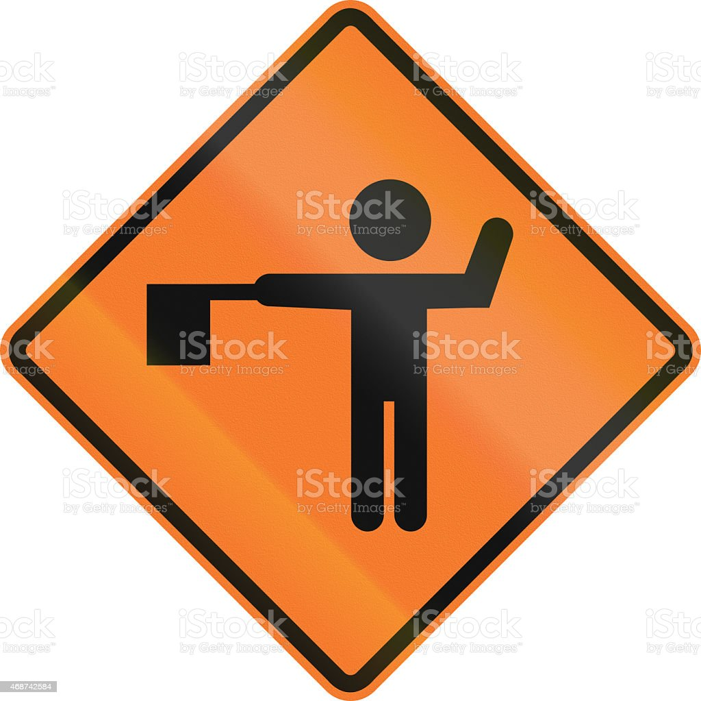 Flaggers In Road Ahead In Chile stock photo