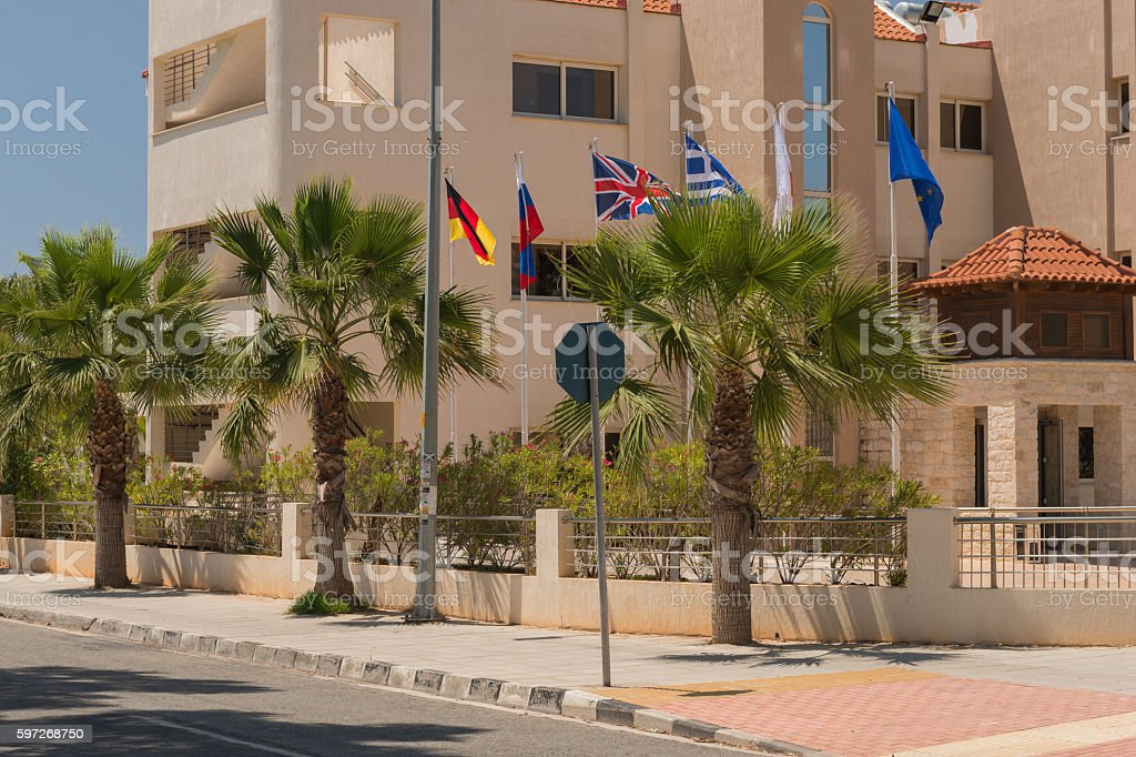 flagpoles with flags in the street royalty-free stock photo