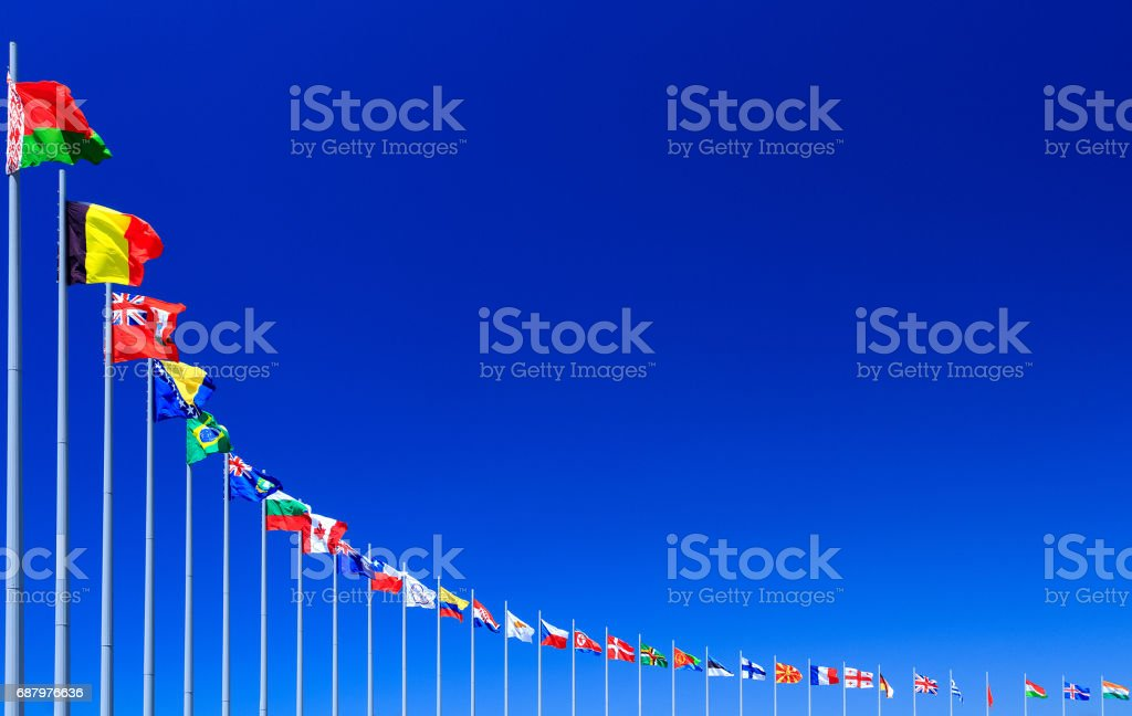 Flags against blue sky stock photo