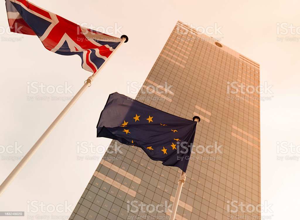 Flags against European skyscraper in Brussels, looking up stock photo