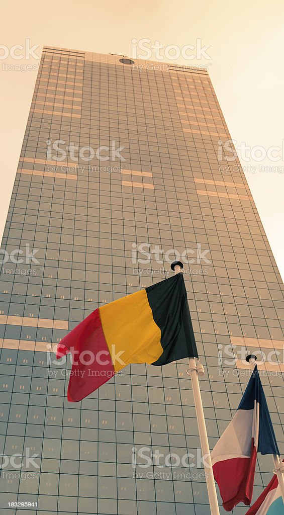 Flags against European skyscraper Parliament in Brussels royalty-free stock photo
