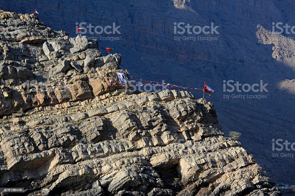 Flags along Musandam coast, Oman stock photo