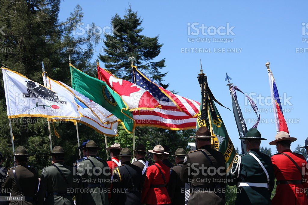 Flags and Police Officers marching royalty-free stock photo