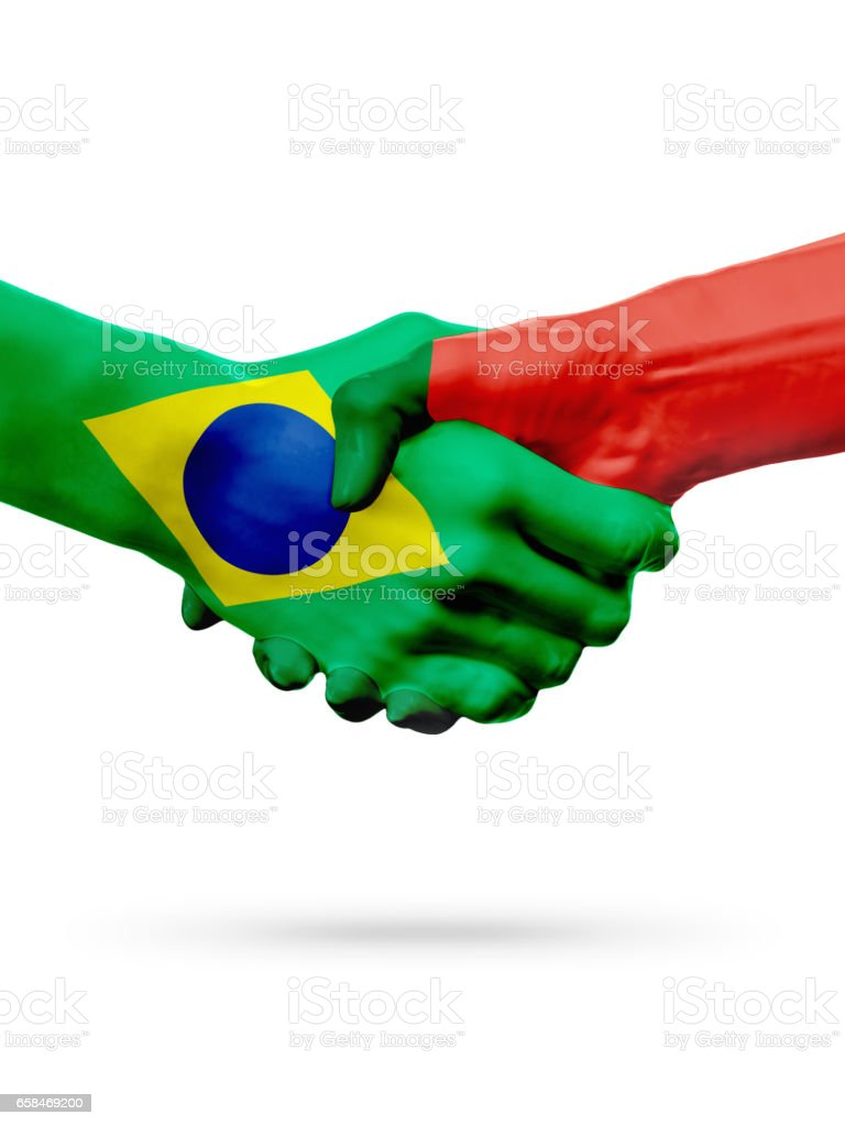 Flags Brazil, Portugal countries, partnership friendship handshake concept. - foto de acervo