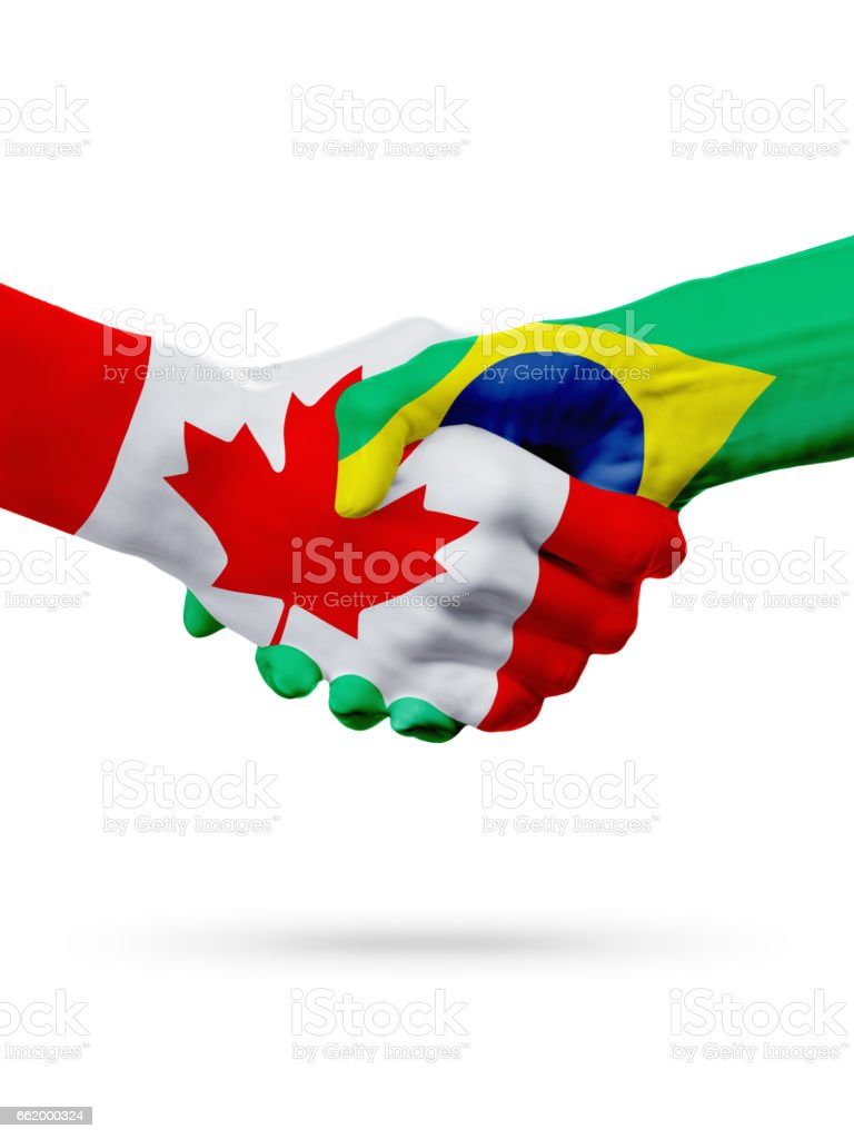 Flags Canada, Brazil countries, partnership friendship handshake concept. royalty-free stock photo