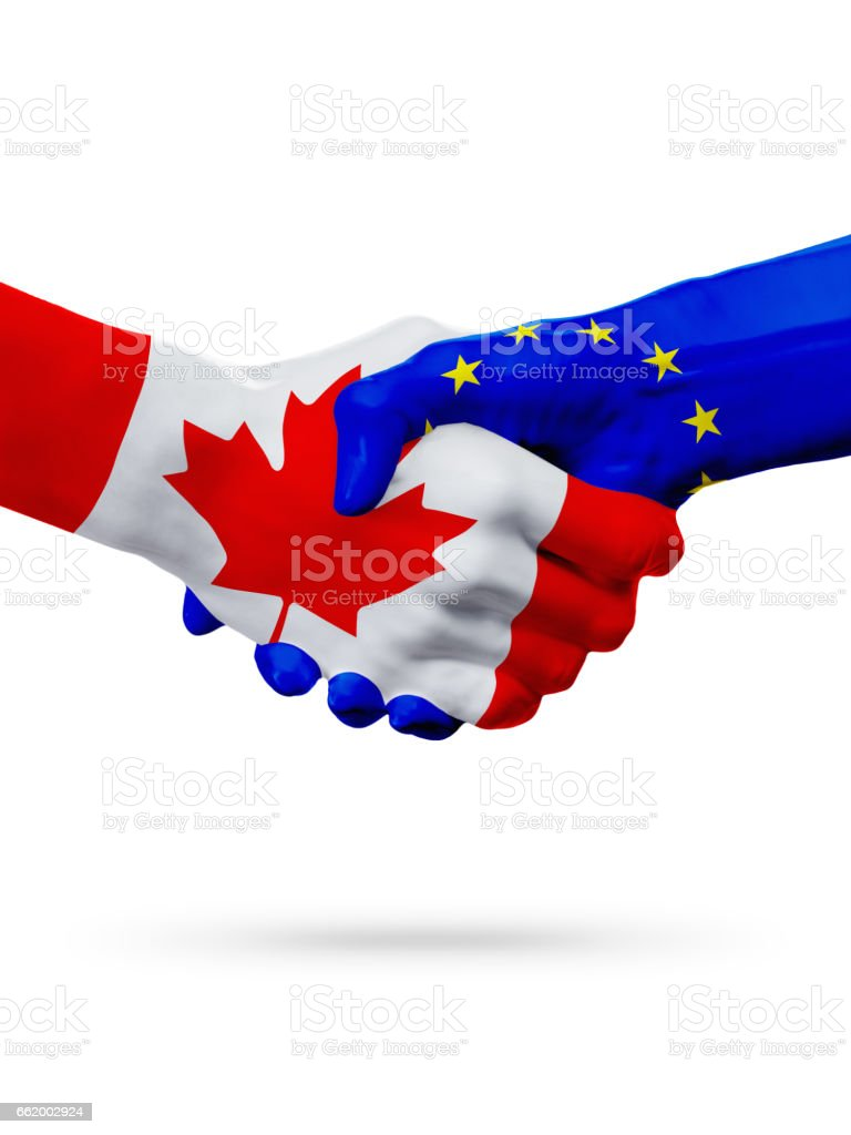 Flags Canada, European Union countries, partnership friendship handshake concept. royalty-free stock photo
