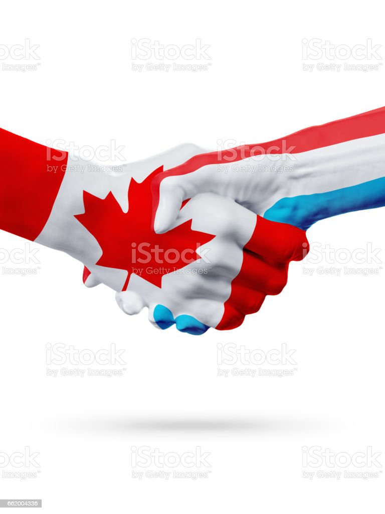 Flags Canada, Luxembourg countries, partnership friendship handshake concept. royalty-free stock photo