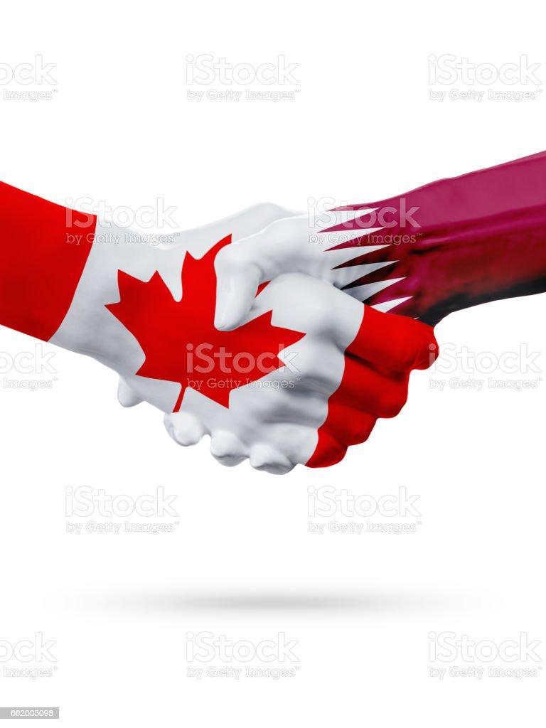 Flags Canada, Qatar countries, partnership friendship handshake concept. royalty-free stock photo