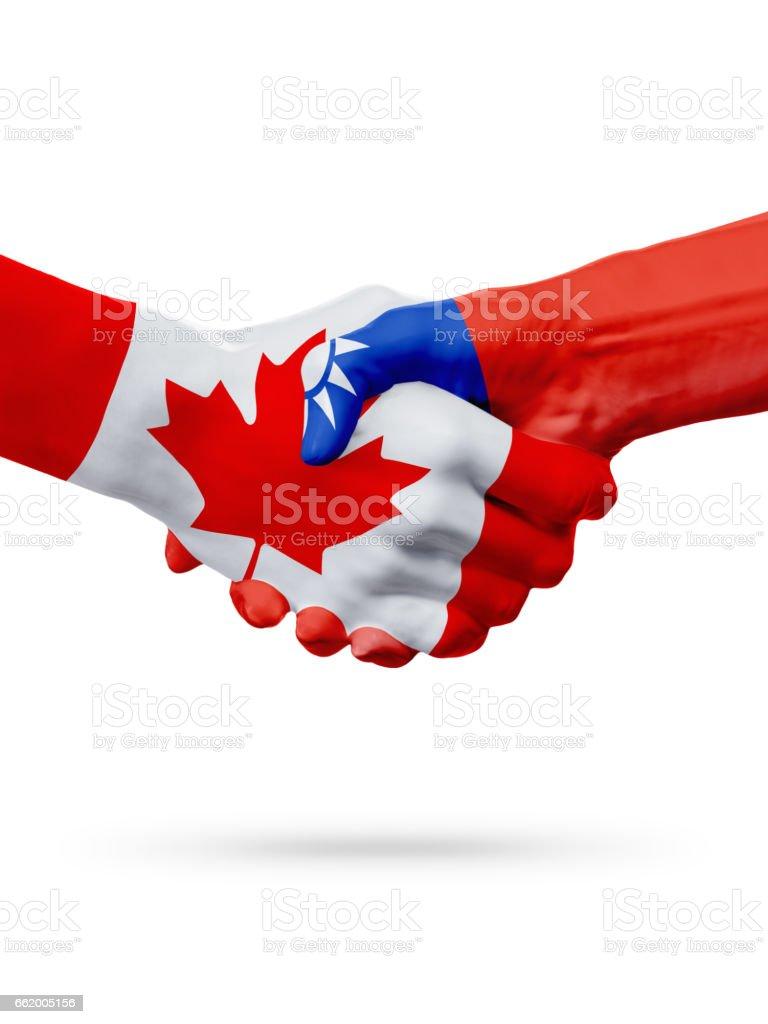 Flags Canada, Taiwan countries, partnership friendship handshake concept. royalty-free stock photo