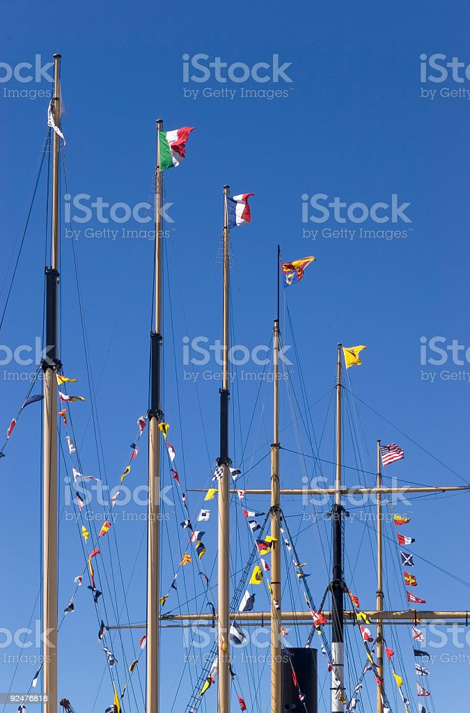Flags fluttering from ship masts royalty-free stock photo