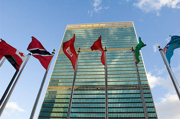 Flags flying in the wind at the united nations building picture id176766479?b=1&k=6&m=176766479&s=612x612&w=0&h=ee9s5cacp6u ydpj9plo0swhgz0mlewtiotizhopblg=