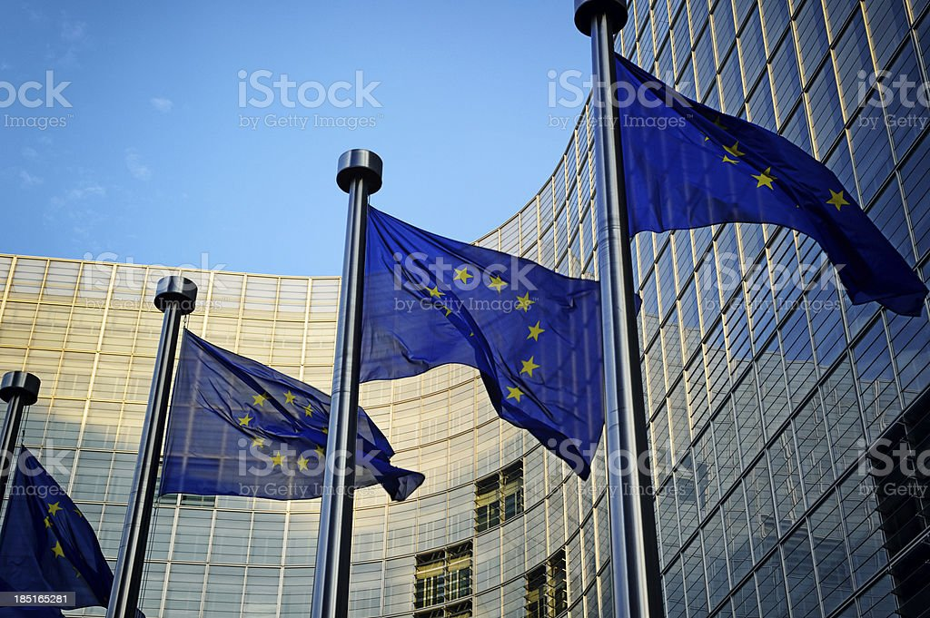 EU flags in front of European Commission stock photo
