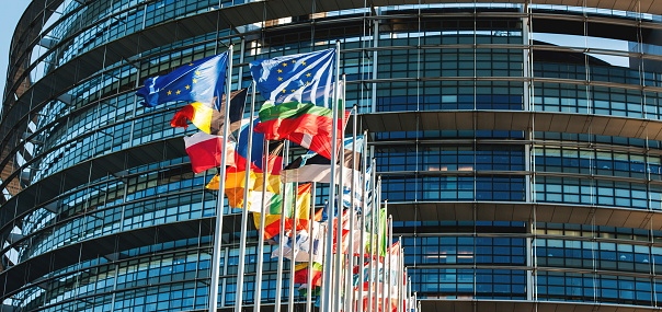 istock EU flags in front of Parliament waving in wind 618870216