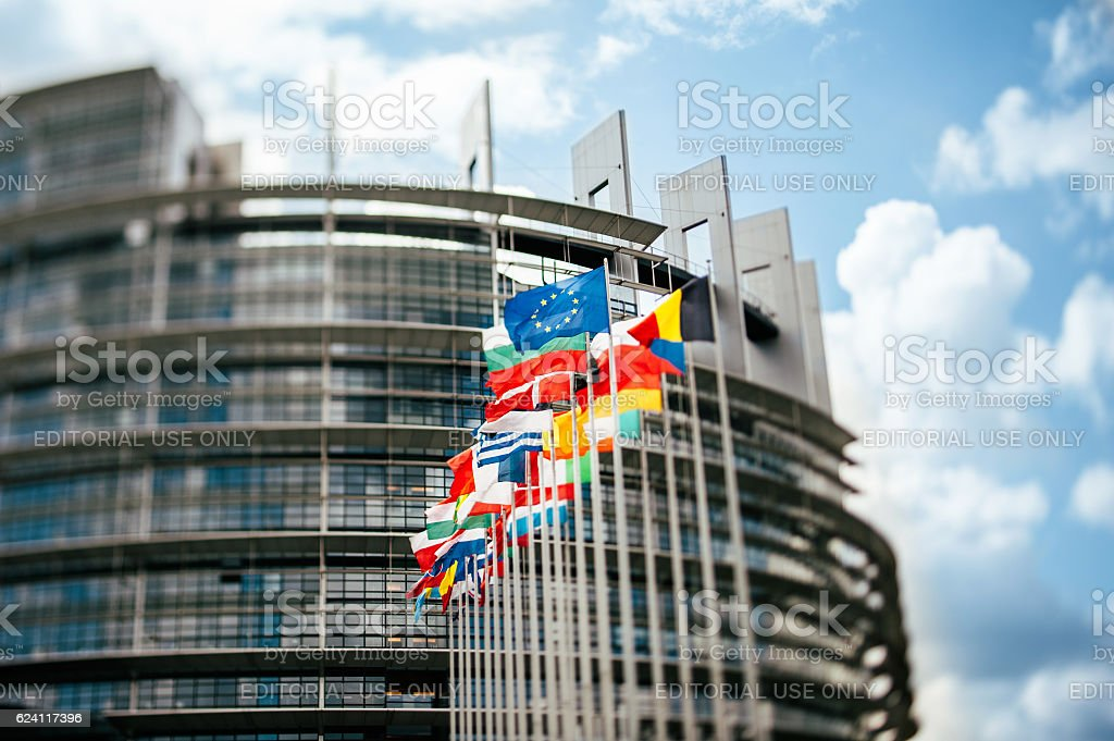 Flags in front of the European Parliament tilt-shift stock photo