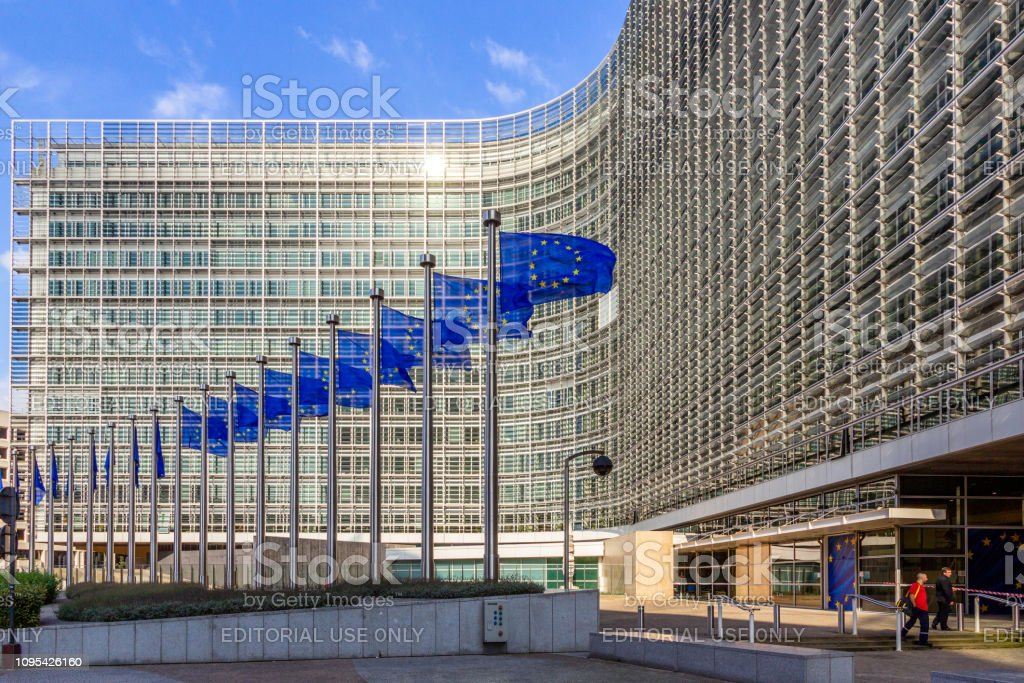EU Flags in front of the European Union building Brussels, Belgium - July 30, 2014: Row of EU Flags in front of the European Union Commission building in Brussels. Architecture Stock Photo
