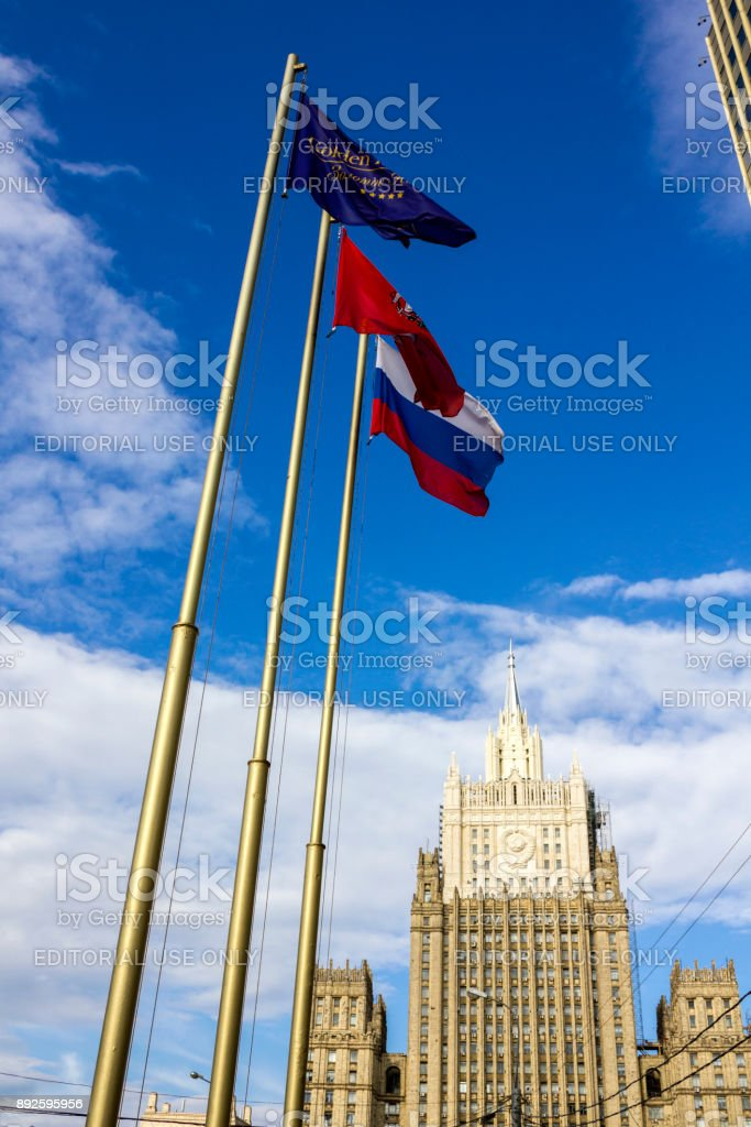 Flags in front of the exterior of the building of Ministry of Foreign Affairs of Russia in Moscow. stock photo