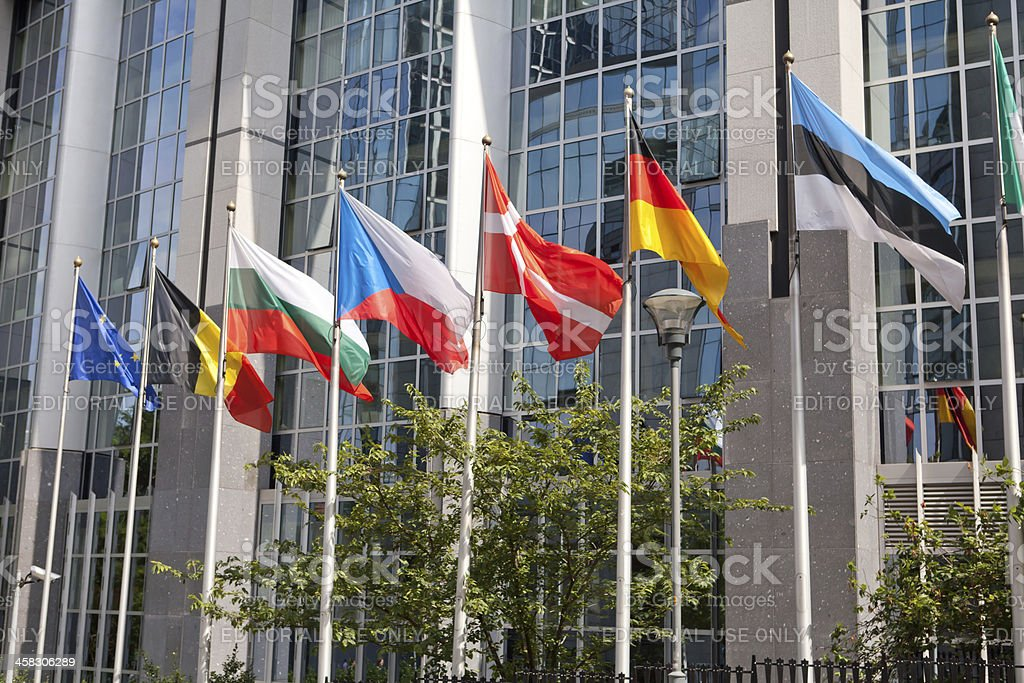 flags in front ot European Parliament Building royalty-free stock photo