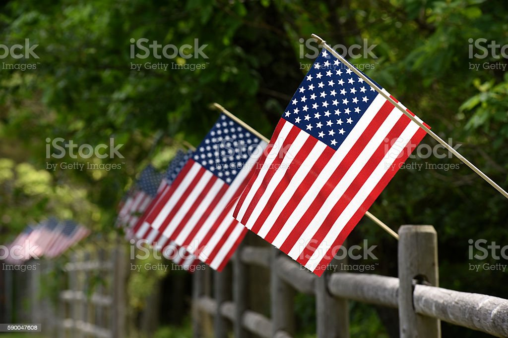 USA flags in  Row on a fence stock photo