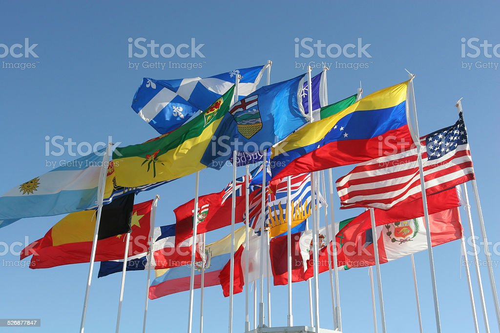 Flags in wind fluttering on blue sky stock photo