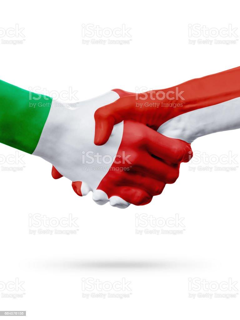 Flags Italy, Monaco countries, partnership friendship handshake concept. royalty-free stock photo