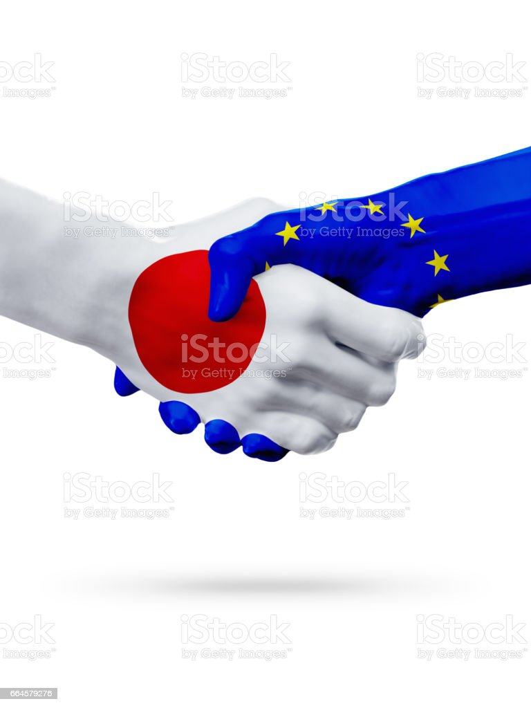 Flags Japan, European Union countries, partnership friendship handshake concept. royalty-free stock photo