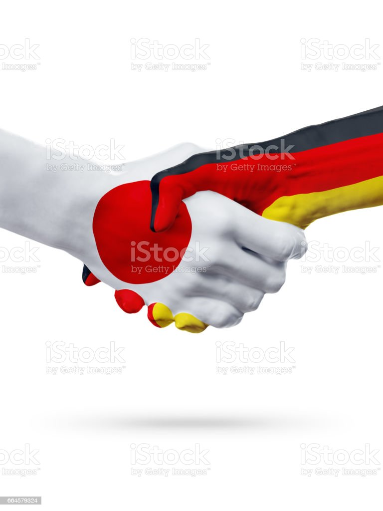 Flags Japan, Germany countries, partnership friendship handshake concept. royalty-free stock photo