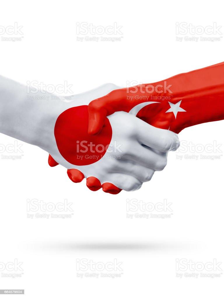 Flags Japan, Turkey countries, partnership friendship handshake concept. royalty-free stock photo