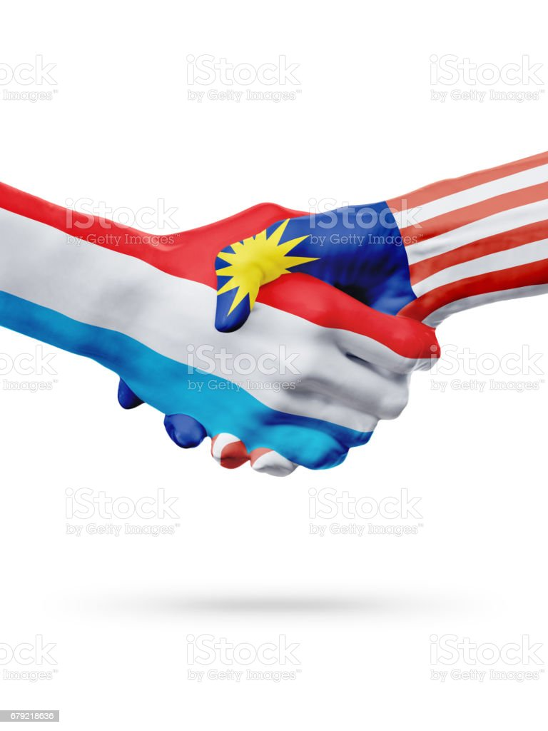 Flags Luxembourg, Malaysia countries, partnership friendship handshake concept. photo libre de droits