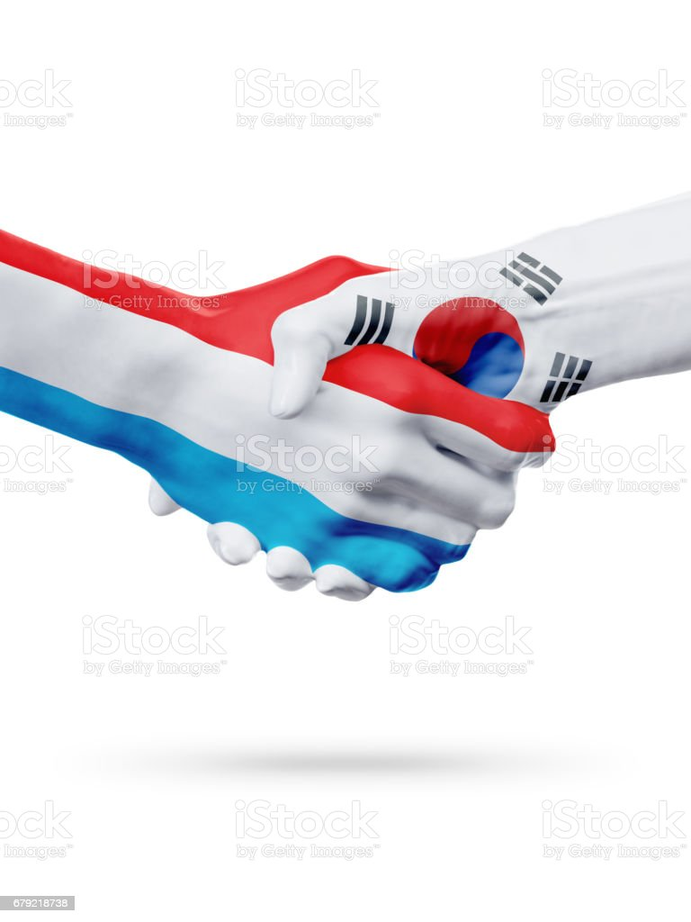 Flags Luxembourg, South Korea countries, partnership friendship handshake concept. photo libre de droits