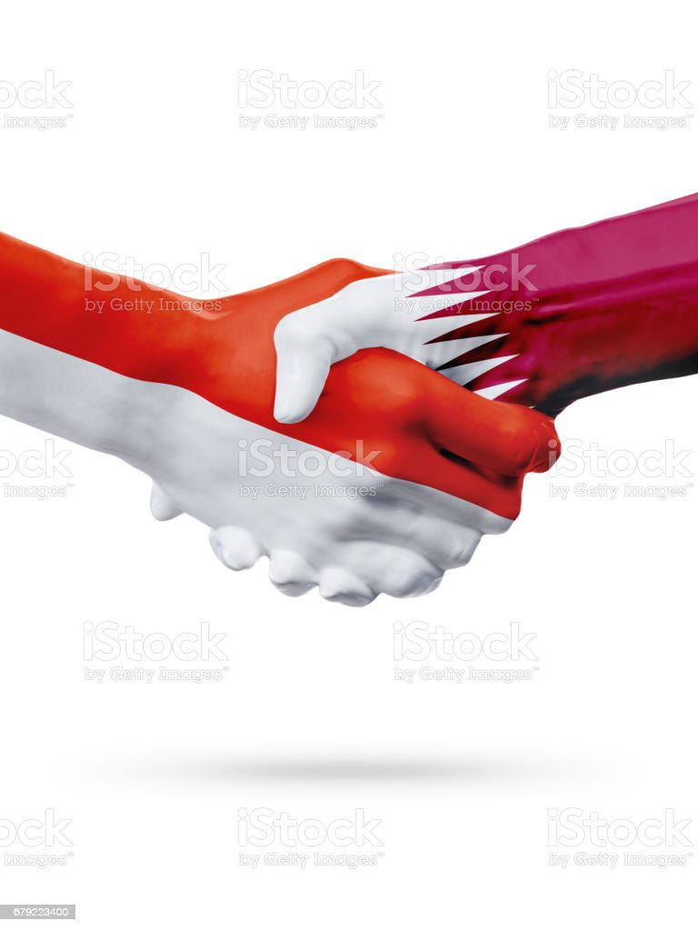 Flags Monaco, Qatar countries, partnership friendship handshake concept. photo libre de droits
