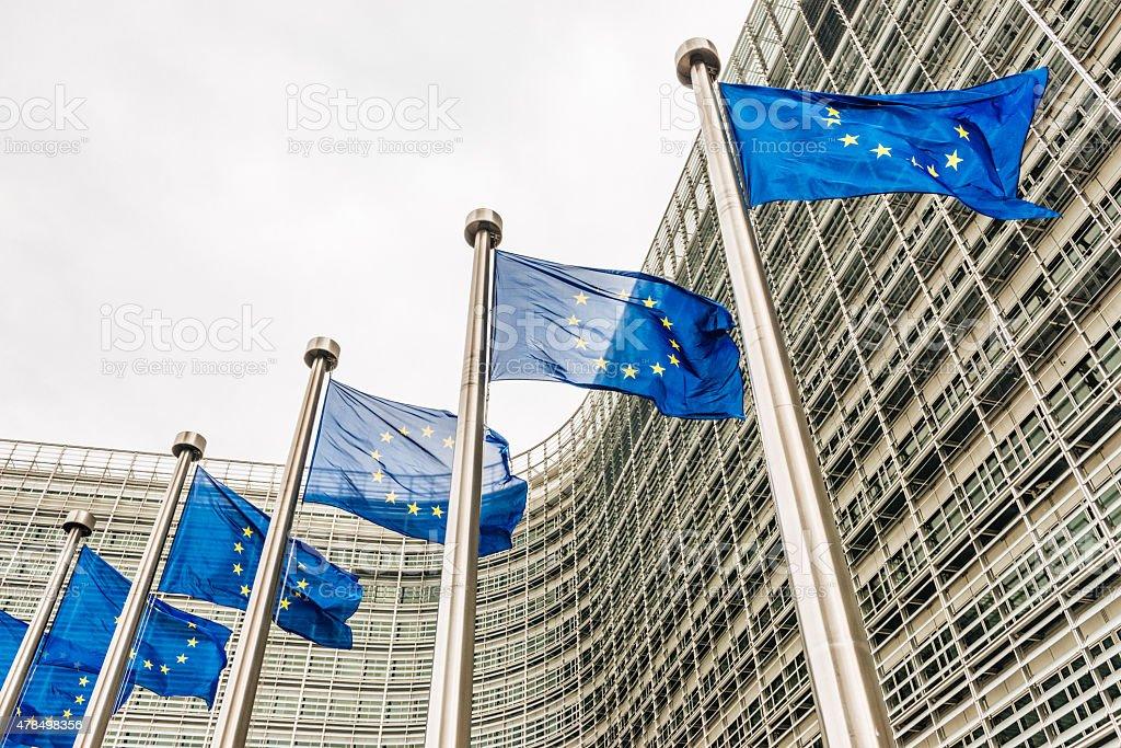 EU flags near EU headquarters Berlaymont European Commission building stock photo
