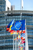 Strasbourg: Vertical image flags of all member states of the European Union waving in calm wind in front of the Parliament headquarter on the day of 2019 European Parliament election
