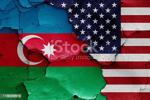 istock flags of Azerbaijan and USA painted on cracked wall 1156358915