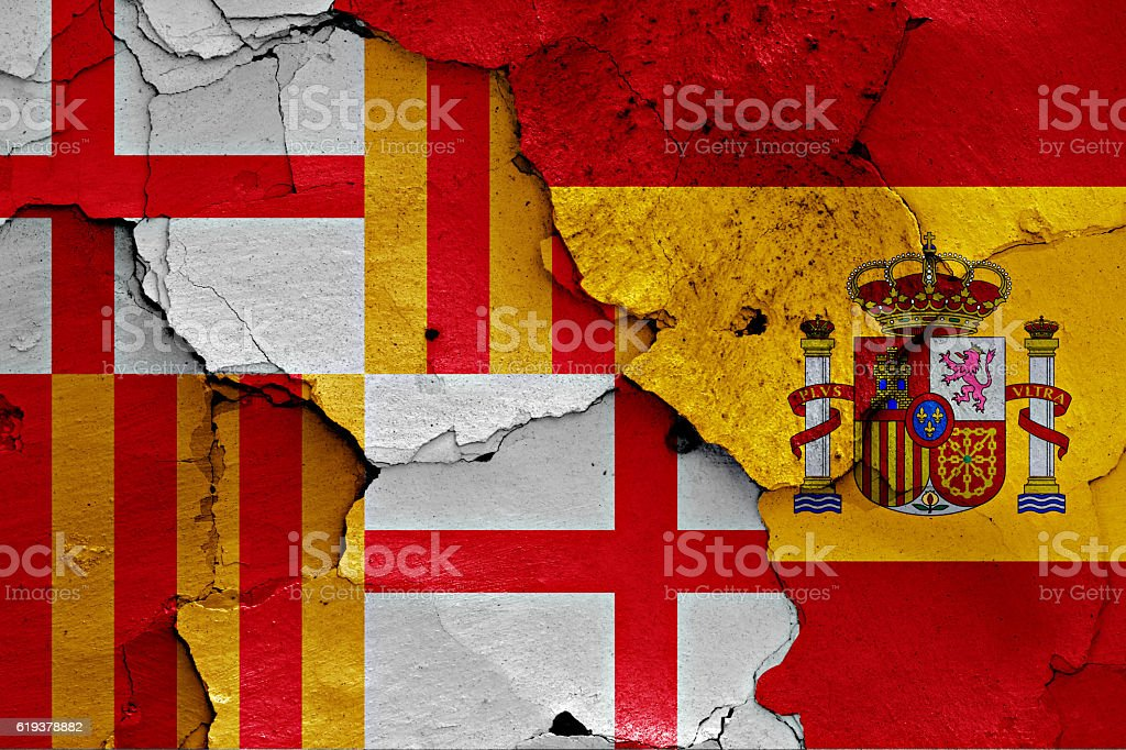 flags of Barcelona and Spain painted on cracked wall stock photo