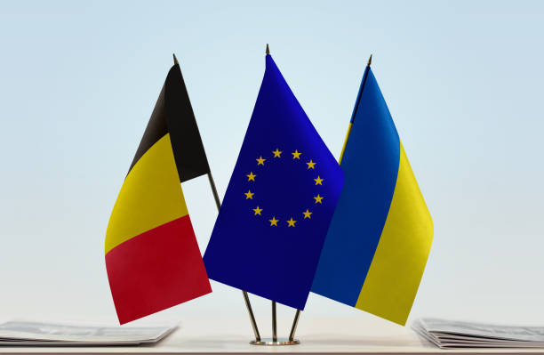 flags of belgium european union and ukraine - conferences stock photos and pictures