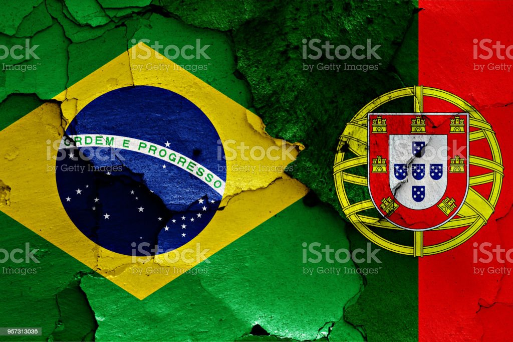 flags of Brazil and Portugal painted on cracked wall - fotografia de stock