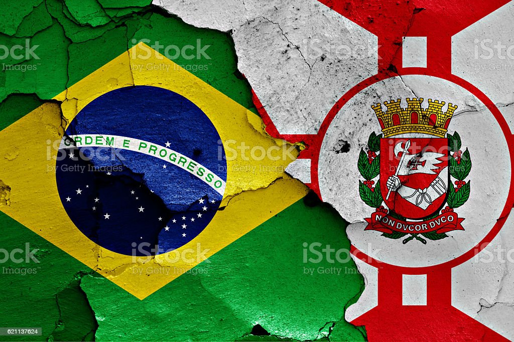 flags of Brazil and Sao Paulo painted on cracked wall stock photo