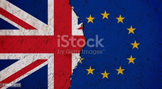 Flags of Britain and European Union painted on cracked wall background