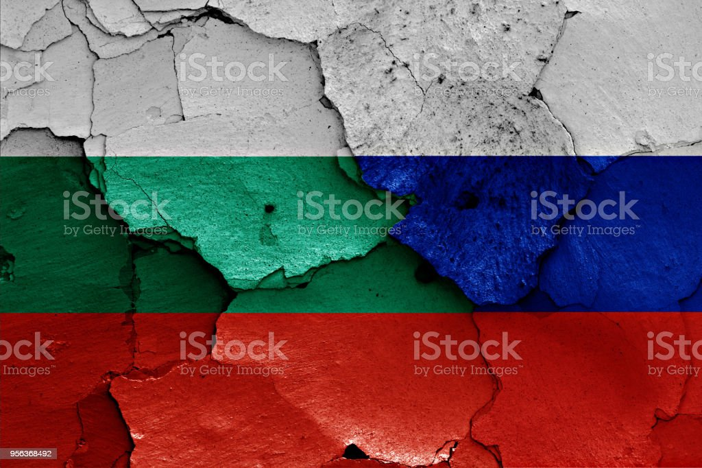 flags of Bulgaria and Russia painted on cracked wall stock photo