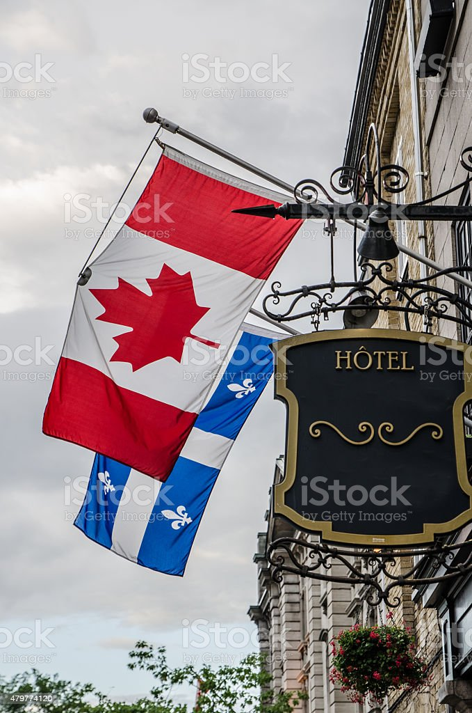 Flags of Canada and Quebec stock photo