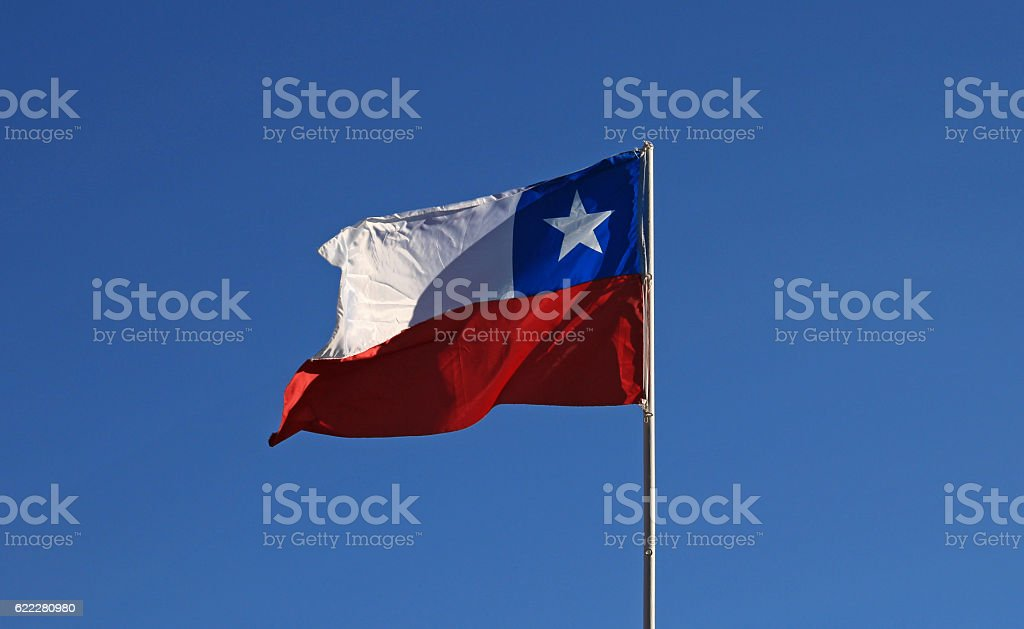 Flags of Chile on the sky - foto de acervo