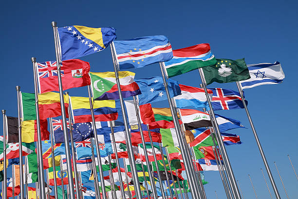 Flags of countries around the world Flags of all nations of the world are flying in blue sunny sky national flag stock pictures, royalty-free photos & images