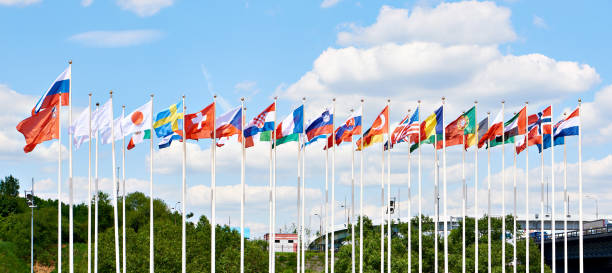 Flags of countries on flagpoles business stock photo