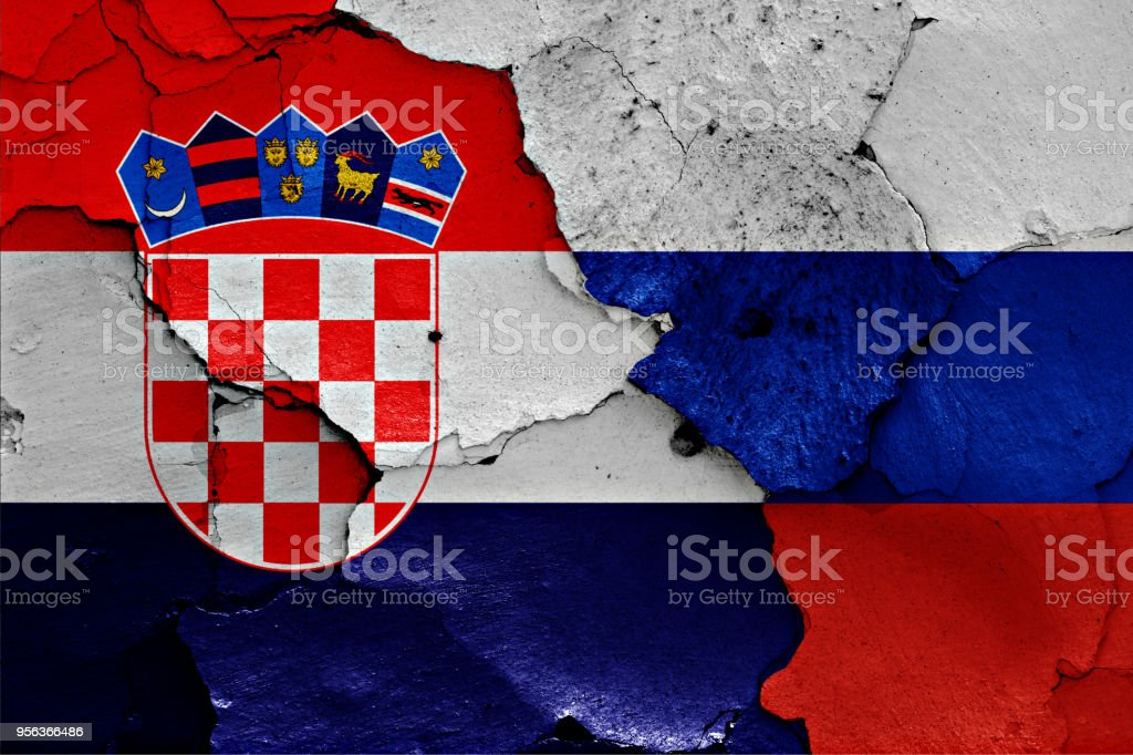 flags of Croatia and Russia painted on cracked wall stock photo