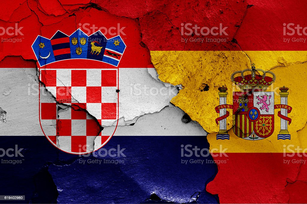 flags of Croatia and Spain painted on cracked wall stock photo