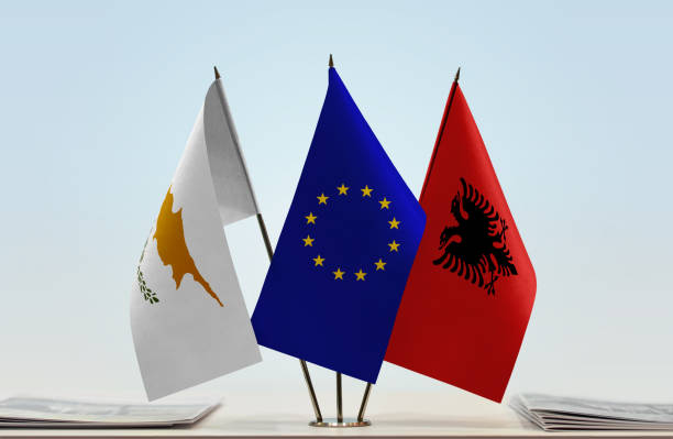 flags of cyprus european union and albania - conferences stock photos and pictures